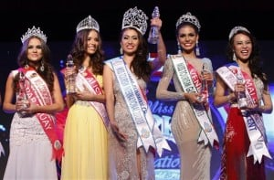 Newly crowned Miss Tourism International 2012 World Final Rizzini Alexis Gomez, center, of Philippines poses for a photo with first runner-up Monika Radulovic, second from left, of Australia, second runner-up Marielis Alejandra Castellanos Perez, second from right, of Venezuela, third runner-up Lourdes Maria Del Carmen Motta Rolon, left, of Paraguay, and fourth runner-up Jun Yong Wan Jun of Malaysia after the beauty pageant during the New Year's Eve celebrations in Petaling Jaya, near Kuala Lumpur, Malaysia, Monday, Dec. 31, 2012. (AP Photo/Lai Seng Sin)