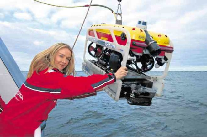 COUSTEAU with a remotely operated underwater vehicle (ROV) camera in a publicity shot forOceana International, photographed by Carlos Suarez